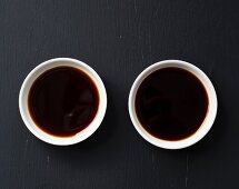 Soy sauce and tamari sauce in small bowls