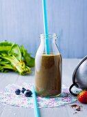 A wild herb smoothie with apples, berries and chia seed gel