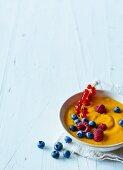 Apple and carrot porridge with fresh berries (Paleo)