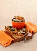 Bruschetta topped with grilled mushrooms