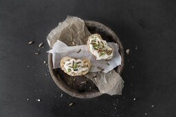 Slices of baguette spread with cream cheese, cress and crickets