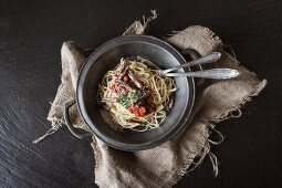 Spaghetti with red sauce and grasshoppers
