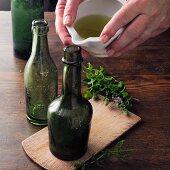 Spearmint wine à la Hildegard von Bingen being poured into bottles