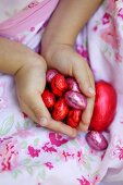 Girl holding an Easter chocolate eggs