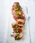 Stuffed pork fillet with figs, hazelnuts and pesto