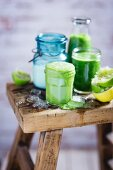Green smoothies on a wooden table
