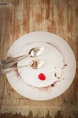 An empty plate with remains of a chocolate cake