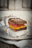 Gluten free buckwheat bread with cheese and tomatoes