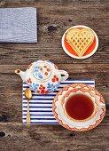 A heart shaped waffle and tea