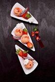 Peach and strawberry ice cream with fresh strawberries and meringue