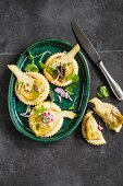 Artichoke cakes with red onions