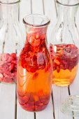 Freeze-dried strawberries and vinegar in preserving bottles