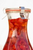 Strawberry vinegar in a preserving bottle