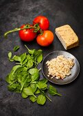 Ingredients for tomato and pearl barley risotto with peanut tofu and spinach