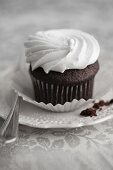 Chocolate cupcake with white frosting