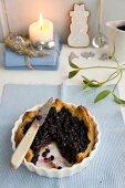 A sliced blueberry shortcrust tart