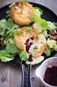 Lettuce with baked camembert, cranberries and hazelnuts