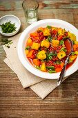 Tomato-infused vegetable stew with polenta croutons