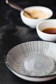 Mizu Shingen Mochi (Japanese raindrop cake) on a black-and-white plate