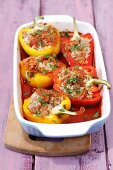 Stuffed peppers with rice and pork in tomato sauce