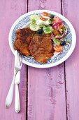 Grilled pork collar steaks with Greek salad