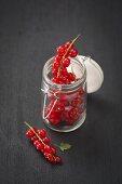 Redcurrants in a flip-top jar