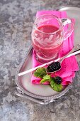 A pink smoothie made with apples, beetroot and banana