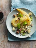 Poached pears with Stilton, celery and walnuts