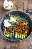 Leeks and asparagus baked with breadcrumbs and goji berries