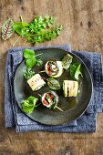 Grilled courgette rolls filled with Robiola cheese and goji berries (top view)