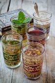 Five different oriental teas in tea glasses