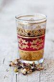 Lebanese flower tea in an oriental tea glass