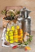 Various bottles of oil in a bottle basket
