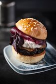 A mini burger with beetroot, aubergines and red basil