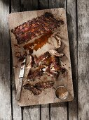 Spare ribs with an oriental marinade on a wooden board