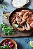Pan Fried Shrimp in Skillet; Peels and a Glass of Beer