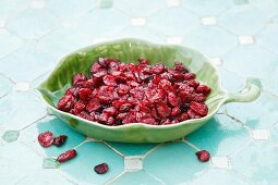 Dried cranberries in a leaf-shaped dish