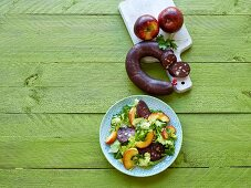 Chicory salad with black pudding and apple wedges
