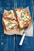Oven-baked frittata with tomatoes, feta cheese, olives and peppers