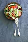 A summer salad with tomatoes, cucumber and red onions