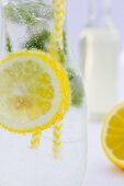 Lemonade with peppermint in a glass bottle (close up)