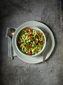 Courgette tagliatelle with a lime and avocado salsa and tomatoes