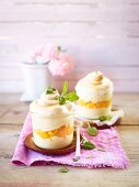Peach and vanilla cream deserts topped with meringue