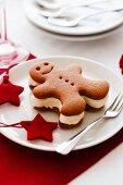 A Christmas gingerbread man ice cream sandwich