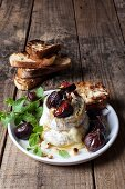 Camembert with poached figs, macadamia-nut brittle and fynbos honey