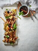 A salad of fried parsnips with fresh figs, croutons, chilli, lemon, and a spicy sherry sauce
