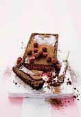 Chocolate tart with truffle cream and raspberry filling