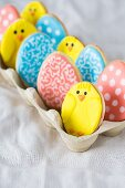 Colourful Easter biscuits in an egg box