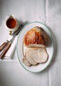 Roast pork with gravy, sliced