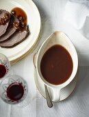 Sauerbraten (marinated pot roast) with sugar beet syrup and raisins